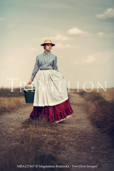 Magdalena Russocka historical woman carrying bucket on country road Women