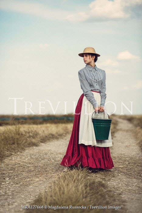 Magdalena Russocka historical woman carrying bucket in fields