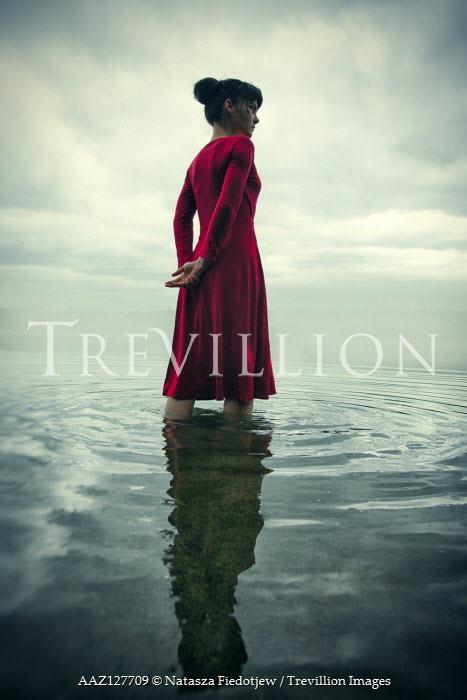 Natasza Fiedotjew Woman in red dress standing in lake