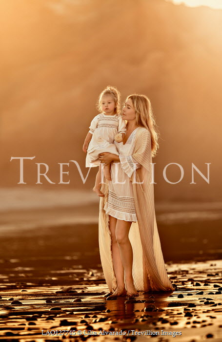 Lilia Alvarado Woman with her daughter on beach at sunset