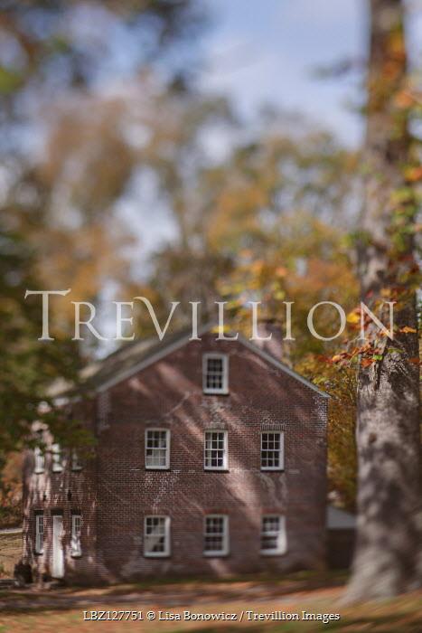 Lisa Bonowicz Brick house and autumn trees