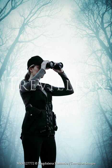 Magdalena Russocka WOMAN WITH BINOCULARS IN FOGGY FOREST Women