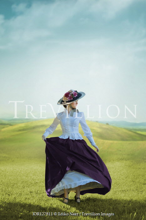 Ildiko Neer Victorian woman dancing in meadow