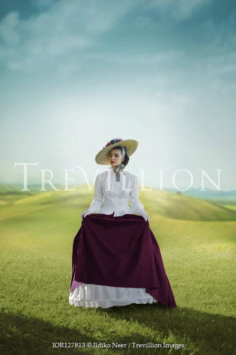 Ildiko Neer Victorian woman walking in meadow