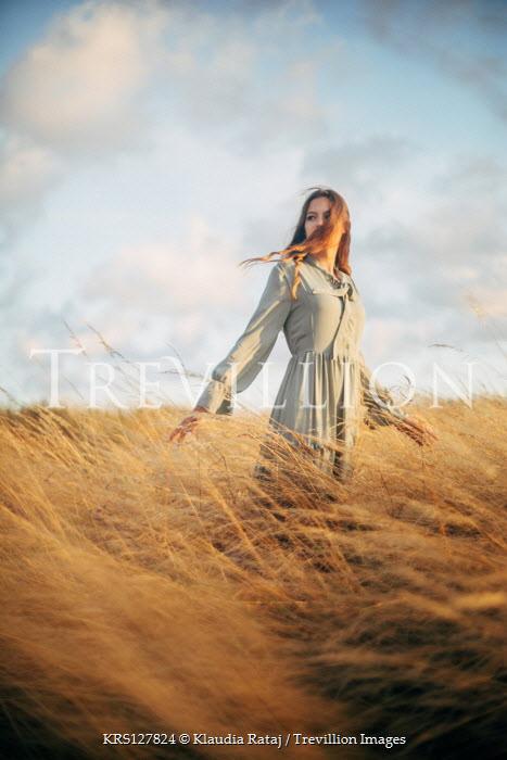 Klaudia Rataj Young woman in field at sunset
