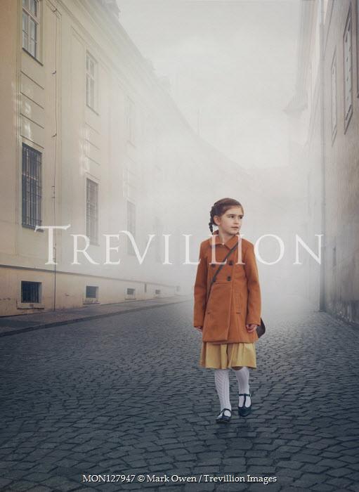 Mark Owen LITTLE GIRL WALKING ON COBBLED CITY STREET Children