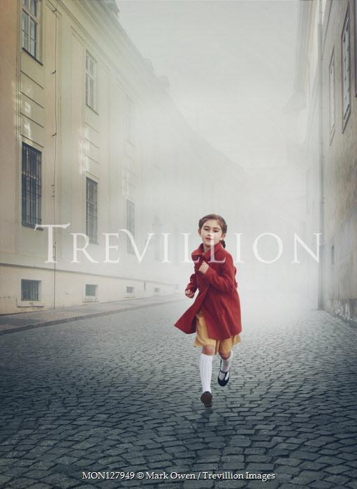 Mark Owen LITTLE GIRL RUNNING ON COBBLED CITY STREET Children
