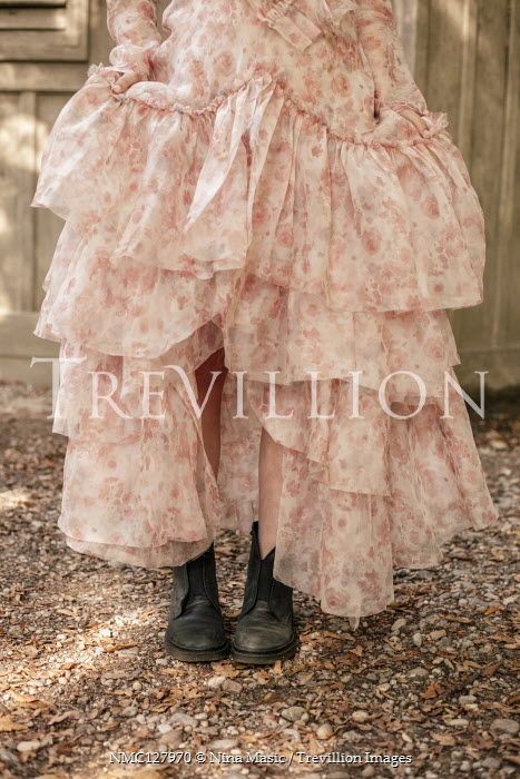 Nina Masic FEMALE LEGS WITH PINK SILKY DRESS AND BOOTS Women