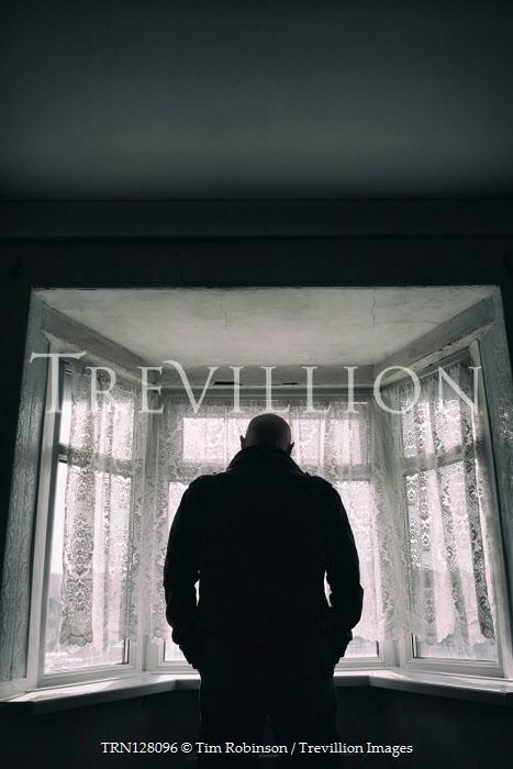 Tim Robinson MAN IN SHADOW WATCHING AT WINDOW INDOORS Men