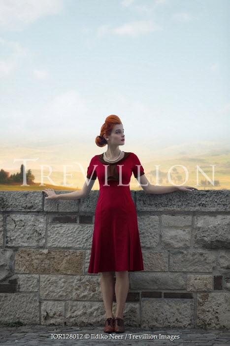Ildiko Neer Vintage woman standing by wall