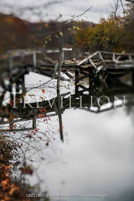 Lisa Bonowicz RIVER WITH BROKEN WOODEN JETTY IN AUTUMN Bridges