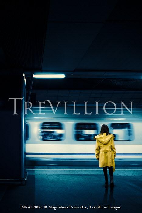 Magdalena Russocka teenage girl standing on platform watching train Children