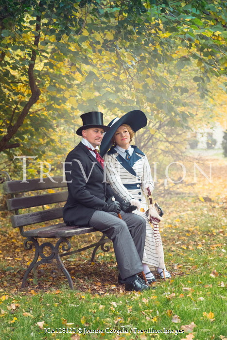 Joanna Czogala EDWARDIAN COUPLE SITTING IN AUTUMN COUNTRYSIDE Couples