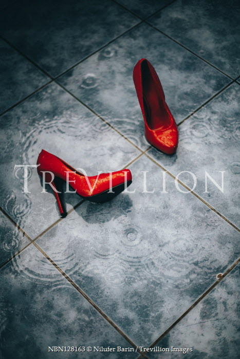 Nilufer Barin PAIR OF RED STILETTOS IN RAIN ON WET TILES Miscellaneous Objects