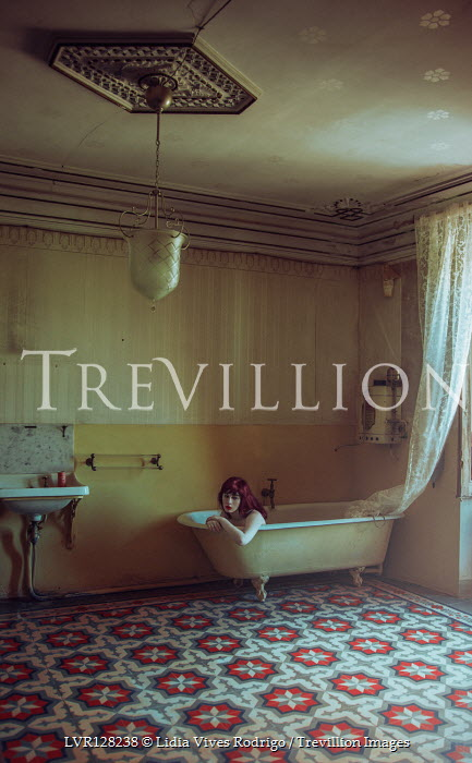 Lidia Vives Rodrigo Young woman lying in bath tub