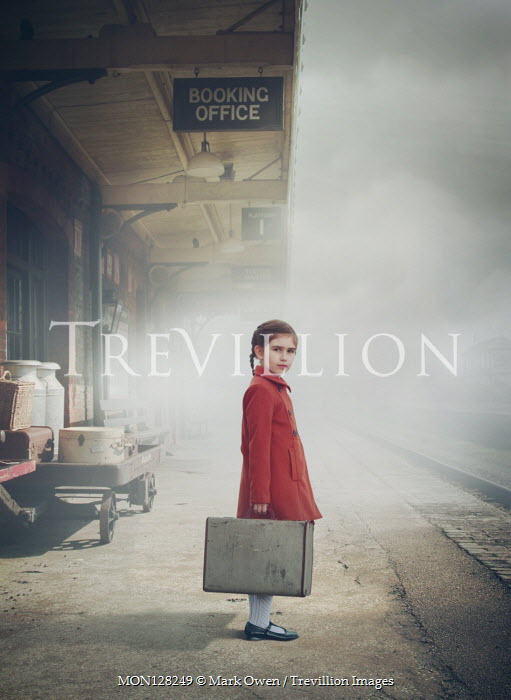 Mark Owen Girl with suitcase at train station