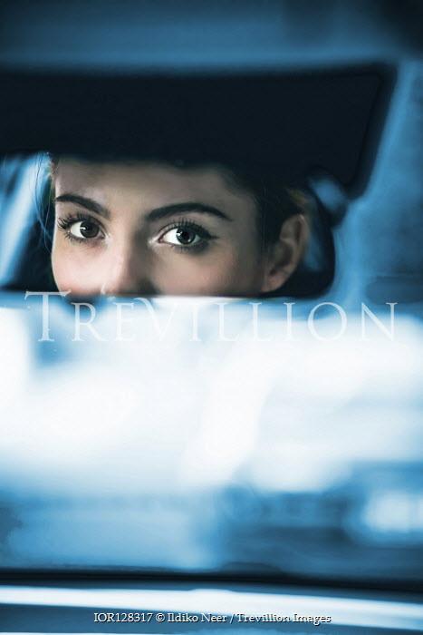Ildiko Neer Woman's eyes reflected in car mirror Women