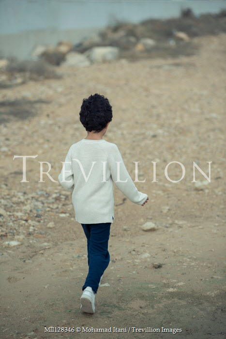 Mohamad Itani Boy walking on beach