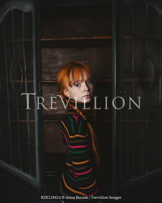 Anna Buczek Girl with red hair in wardrobe