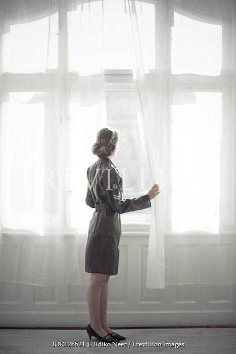 Ildiko Neer Wartime woman in uniform looking out window
