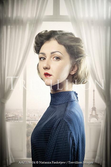 Natasza Fiedotjew young woman standing in window in Paris