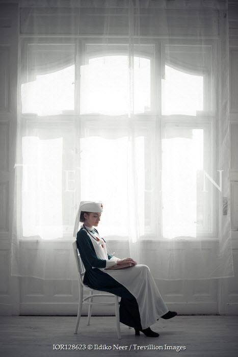 Ildiko Neer Wartime nurse sitting by window