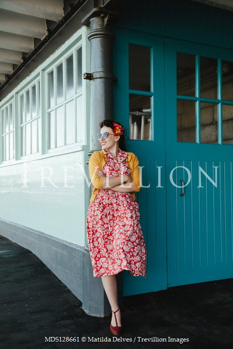 Matilda Delves HAPPY RETRO WOMAN WAITING ON STATION PLATFORM Women
