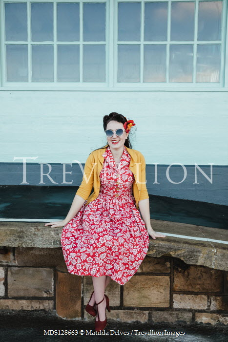 Matilda Delves HAPPY RETRO WOMAN SITTING ON RAILWAY PLATFORM Women