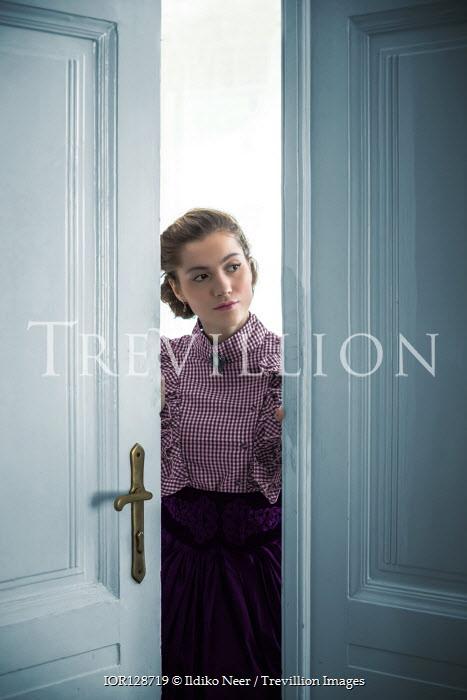 Ildiko Neer Victorian woman peeking from half-opened door