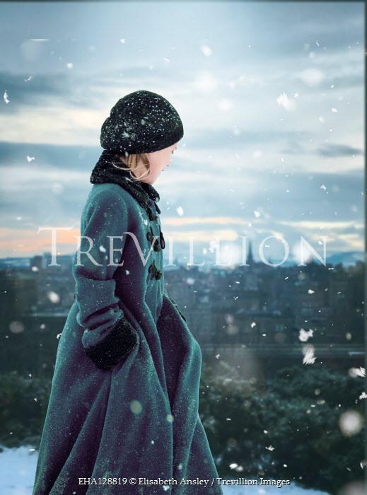Elisabeth Ansley YOUNG GIRL IN COAT WALKING IN SNOW NEAR CITY Children