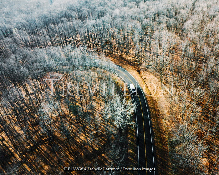 Isabelle Lafrance TRUCK ON COUNTRY ROAD WITH WINTRY TREES Paths/Tracks