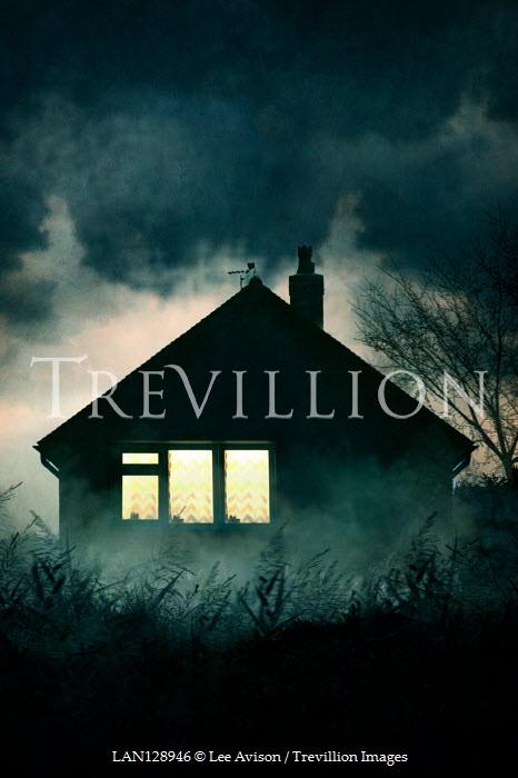 Lee Avison LIGHT IN WINDOWS OF HOUSE AT NIGHT Houses