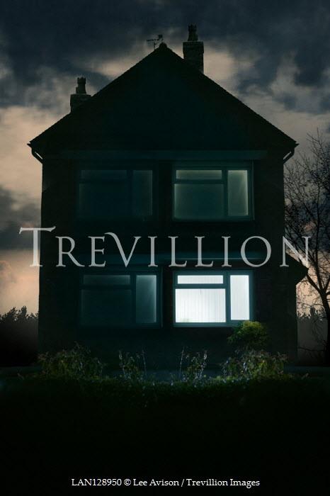 Lee Avison LIGHT IN WINDOW OF HOUSE AT NIGHT Houses