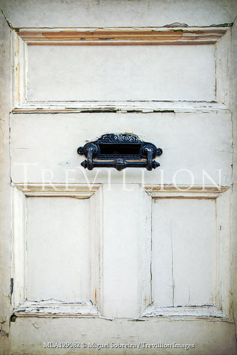 Miguel Sobreira Weathered white door with mail slot