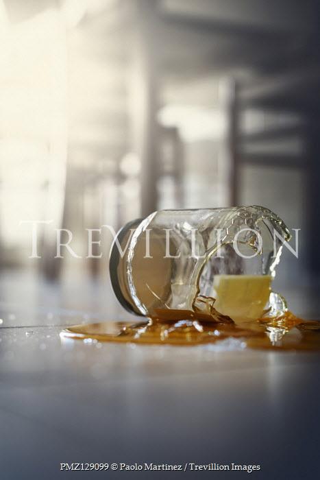 Paolo Martinez Broken jar of honey on tiled floor
