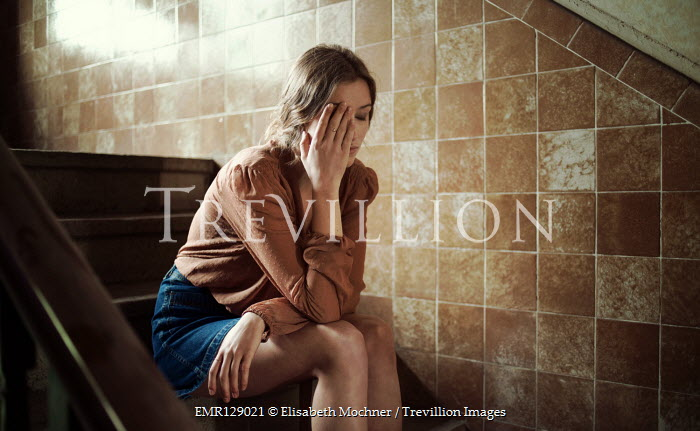 Elisabeth Mochner Sad woman sitting on staircase