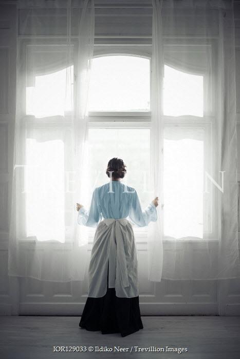 Ildiko Neer Victorian maid standing by windows