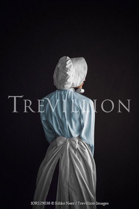 Ildiko Neer Victorian maid in bonnet from behind