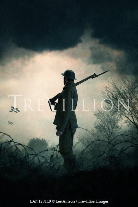 Lee Avison Soldier with rifle standing on battlefield