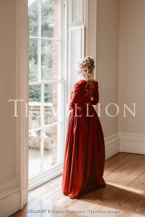 Shelley Richmond Victorian woman in red dress by window