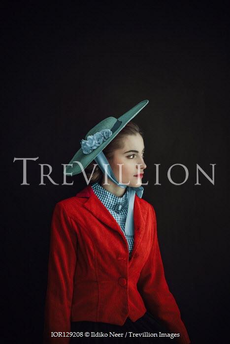 Ildiko Neer Victorian woman in hat and red coat