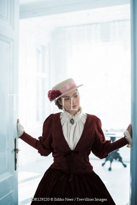Ildiko Neer Victorian woman opening doors