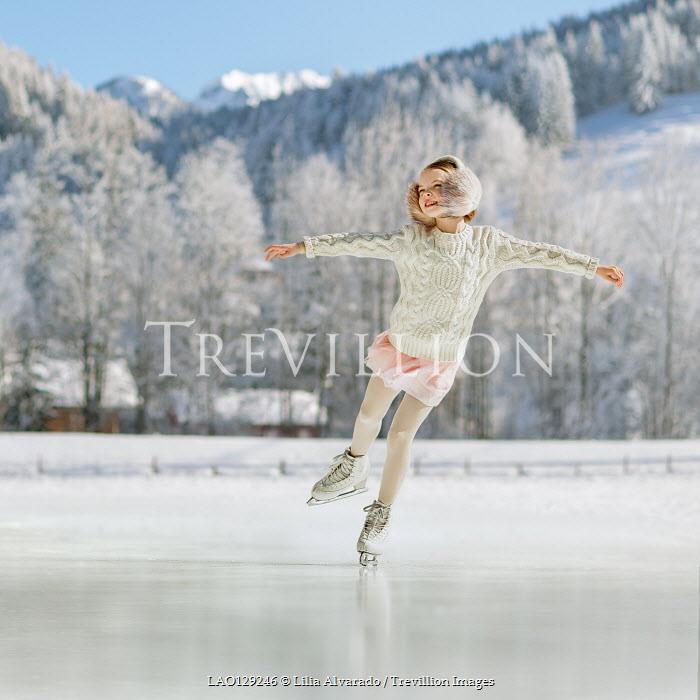Lilia Alvarado Girl ice skating on frozen lake