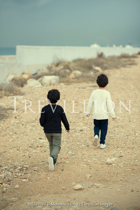 Mohamad Itani Boys walking on beach