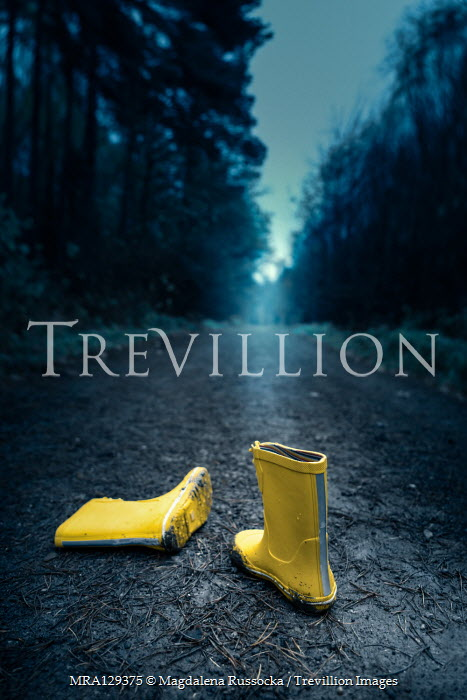 Magdalena Russocka Child's yellow Wellington boots abandoned on forest road