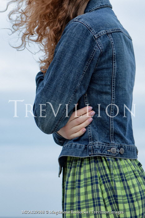 Magdalena Russocka Young woman in denim jacket on beach