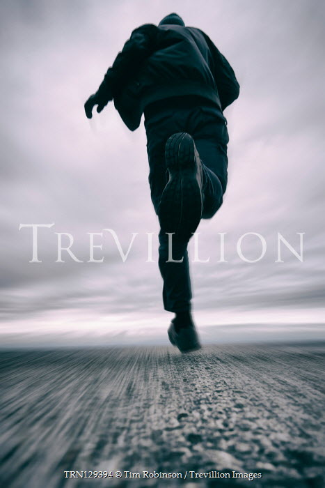 Tim Robinson Man running on road