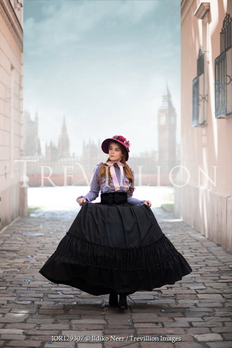 Ildiko Neer Historical woman walking on cobbled street in London