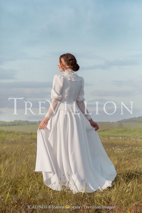 Joanna Czogala WOMAN WITH WHITE GOWN IN SUMMERY COUNTRYSIDE Women
