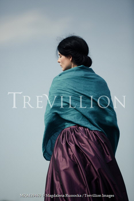 Magdalena Russocka historical woman wrapped in shawl standing outside